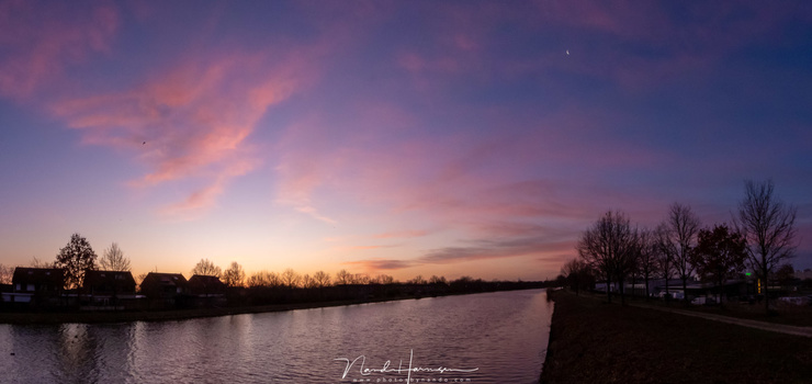A panorama of three individual shots during twilight. This image size shows not much noise, but zoomed in it will be visible. This one is shot in raw, and processed in Lightroom. (3x 24mm (FF equivalent) - ISO720 - f/8 - 1/125 with -0,7EV)