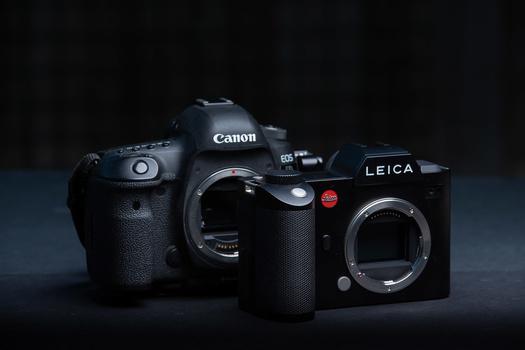 The Canon EOS 5D mark IV DSLR next to the Leica SL mirrorless camera.