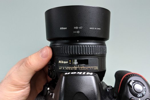 Adjusting the lens' focus ring until it's at the minimum focusing distance