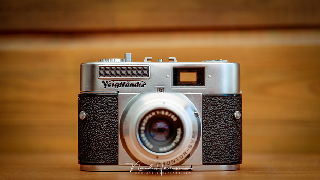 An old Voigtländer camera with a light meter above the company name. It measures the ambient light, nothing more. Today the light meters are more sophisticated.
