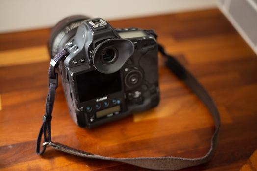 Camera strap and viewfinder hood