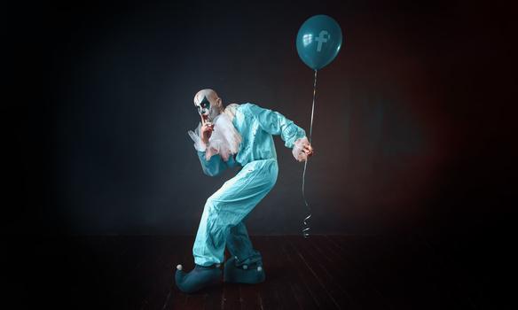 Facebook clown holding a ballon