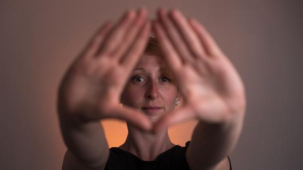 Hands framing face