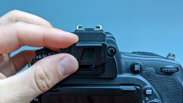 Viewfinder cap on optical viewfinder
