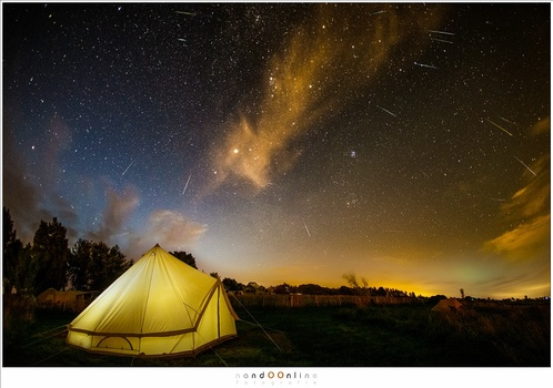 Camping under the stars, while the Perseids roam the night sky. Find a nice location for photographing shootings stars. It will enhance your photo a lot.