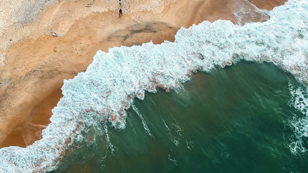 Aerial photo of beach and waves