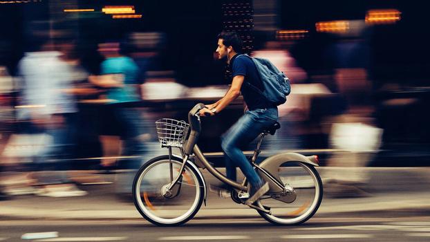 Man cycling through town