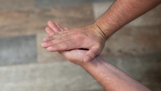 Twist palms anti-clockwise