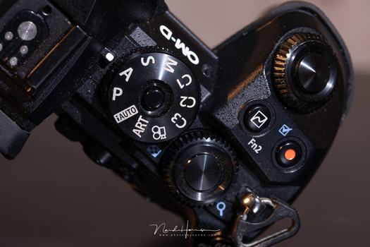Part of the button layout of the Olympus OM-D E-M1 II.