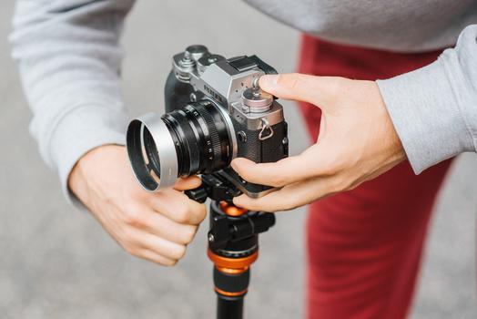 Attaching a Fuji camera to a tripod.