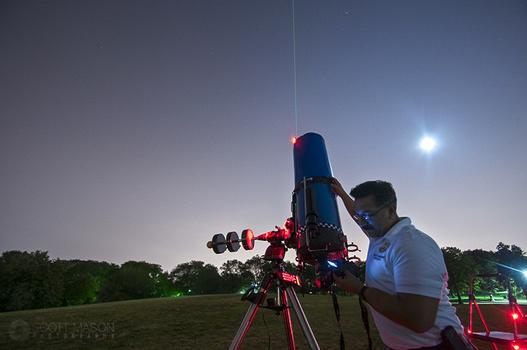 an astronomer performs a polar alignment