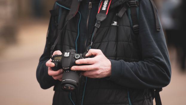 DSLR camera in hands