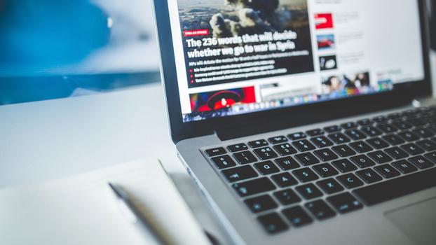 News displayed on laptop