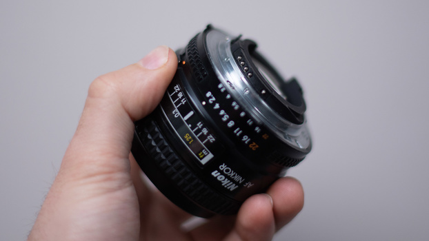 Nikkon 24mm lens in hand
