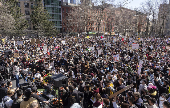 Alice Tsui, a teacher in New York, shares stories of discrimination that she has faced with a packed Columbus Park on Sunday, March 21, 2021 at the AAPI Rally Against Hate. To get this shot, I held my Olympus over my head on a monopod and just poked it ov