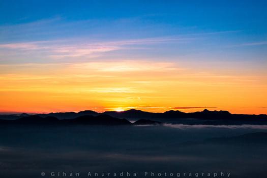 Sun Peaking through mountains