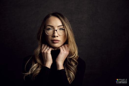 Woman wearing spectacles by Mladen Dakic