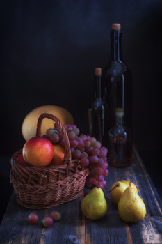 Pears and grapes on a table from old boards