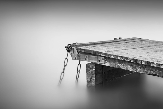 Pier and two chains by Pasi Hotti