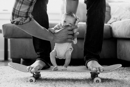 Skateboarding Baby and Father