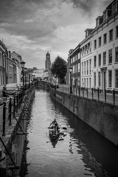 Rowing down the cannals of dutch city Utrecht