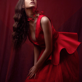 Editorial fashion portrait of Nancy in a red dress by Dilyana Hezhaz