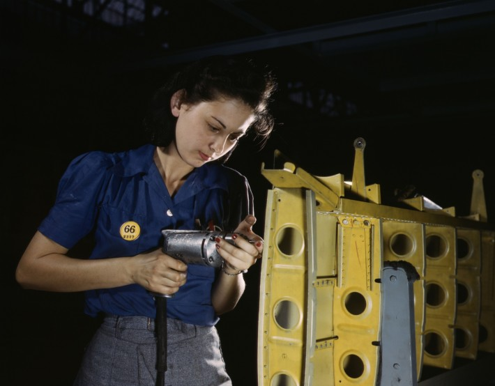 Operating_a_hand_drill_this_woman_worker_is_shown_working_on_the_horizontal_stabilizer