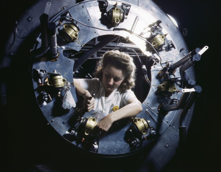 Part_of_the_cowling_for_one_of_the_motors_for_a_B-25_bomber_is_assembled_in_the_engine_department_of_North_American_Aviation
