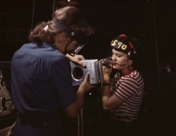 Two_women_employees_of_North_American_Aviation,_Incorporated,_assembling_a_section_of_a_wing_for_a_P-51_fighter_plane