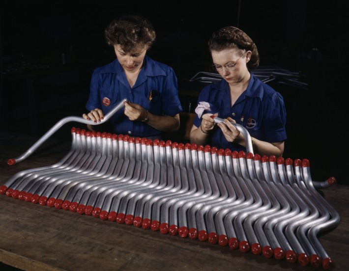Two_women_workers_are_shown_capping_and_inspecting_tubing_which_goes_into_the_manufacture_of_the_Vengeance_(A-31)_dive_bomber_made_at_Vultee's_Nashville_division,_Tennessee