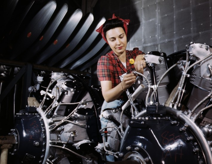 Woman_working_on_an_airplane_motor_at_North_American_Aviation,_Inc.,_plant_in_Calif