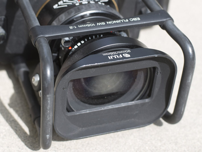 There is essentially a roll cage for added protection that's quite useful. The haze around the lens is the center filter that helps with vignette control, but reduces exposure by 2 stops. A shade should come with your lens.