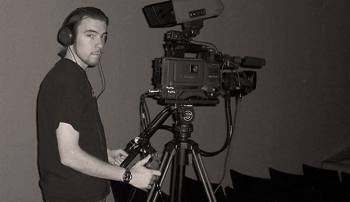 Here is an unfortunate photo of me with a pony tail, working as a part time camera op doing event videography.