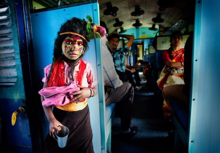 Arup Ghosh, from India, won in the People category, with Poor God, an image taken during the Hindu festival of Durga Puja, showing a child dressed as the Hindu god Shiva.